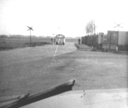 Railway crossing on Butzweilerweg.  This line led into the RAF Station and was used for transporting goods in and out of the site.  A 28 bus can just be seen in the background.